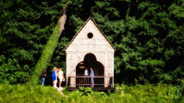 A group of people waiting in front of a gazebo